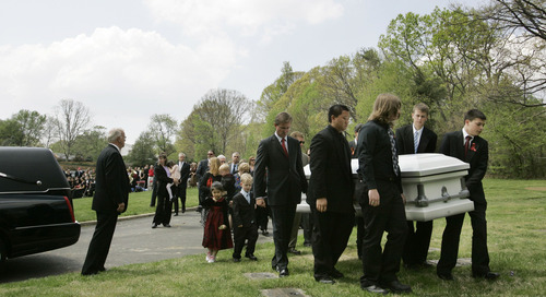 ** RETRANSMISSION FOR ALTERNATE CROP ** Pallbearers carry the casket of Virginia Tech freshman Mary Karen Read, 19, who was killed in last week's shooting, during her funeral at Pleasant Valley Memorial Park in Annandale, Va., Tuesday, April 24, 2007. (AP Photo/Charles Dharapak)