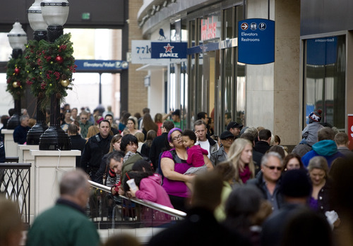 Kim Raff  |  The Salt Lake Tribune People crowd the walkways at City Creek Center in Salt Lake City during one of the last days to shop before Christmas on December 22, 2012.