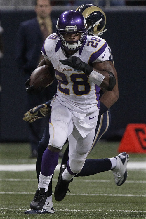 Seth Perlman  |  The Associated Press A comparison between Adrian Peterson and Suzy Favor Hamilton? He won't take that lying down,