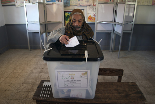 An Egyptian man casts his vote during the second round of a referendum on a disputed constitution drafted by Islamist supporters of President Mohammed Morsi in Fayoum, about 100 kilometers (62 miles) south of Cairo, Egypt, Saturday, Dec. 22, 2012.(AP Photo/Khalil Hamra)
