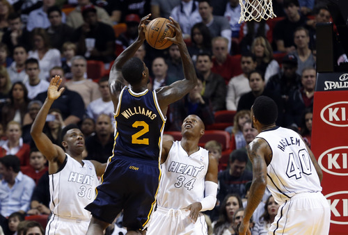 Utah Jazz's Marvin Williams (2) shoots over Miami Heat defenders Norris Cole (30), Ray Allen (34) and Udonis Haslem (40) during the first half of an NBA basketball game in Miami, Saturday, Dec. 22, 2012. (AP Photo/Alan Diaz)