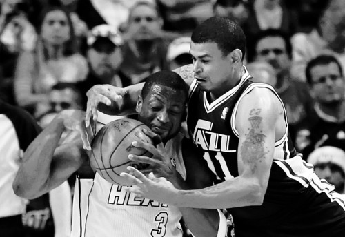 Utah Jazz's Earl Watson (11) pressures Miami Heat's Dwyane Wade during the first half of an NBA basketball game in Miami, Saturday, Dec. 22, 2012. The Heat won 105-89. (AP Photo/Alan Diaz)