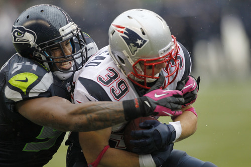 New England Patriots' Danny Woodhead is hit by Seattle Seahawks' Bobby Wagner in the second half of an NFL football game, Sunday, Oct. 14, 2012, in Seattle. (AP Photo/John Froschauer)