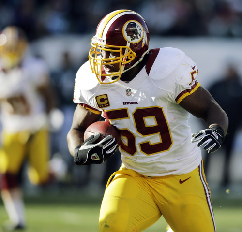 Washington Redskins' London Fletcher returns an interception in the first half of an NFL football game against the Philadelphia Eagles, Sunday, Dec. 23, 2012, in Philadelphia. (AP Photo/Mel Evans)