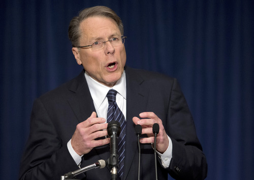 """The National Rifle Association executive vice president Wayne LaPierre, gestures during a news conference in response to the Connecticut school shooting on Friday, Dec. 21, 2012 in Washington.  The nation's largest gun-rights lobby is calling for armed police officers to be posted in every American school to stop the next killer """"waiting in the wings.""""  (AP Photo/ Evan Vucci)"""