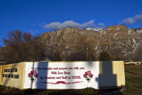 Chris Detrick  |  The Salt Lake Tribune A sign put up by the Utah Schools for the Deaf and the Blind in Ogden on Wednesday, Dec. 19, 2012. The pink helps commemorate young Emilie Parker, who was one of the children killed in the shooting at the Connecticut elementary school.