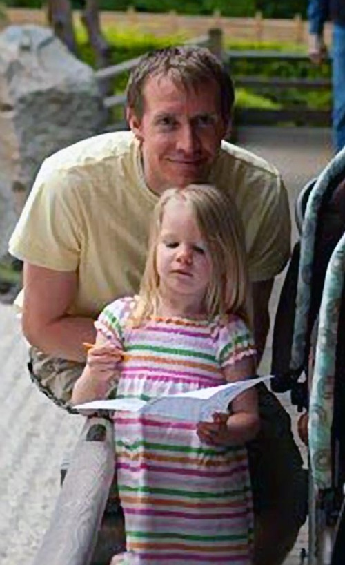 This photo posted to the Emilie Parker Fund Facebook page shows Emilie Parker and her father Robbie Parker. Fighting back tears and struggling to catch his breath, Robbie Parker the father of  6-year-old Emile Parker who was gunned down in Friday's school shooting in Connecticut told the world about a little girl who loved to draw and was always smiling, and he also reserved surprising words of sympathy for the gunman. (AP Photo/Emilie Parker Fund)