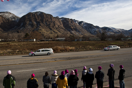 Chris Detrick  |  The Salt Lake Tribune High School students from around Davis County release pink balloons on the sidewalk along Monroe Blvd, as Emilie Parker's hearse passes on the way to Myers Evergreen Memorial Park Saturday December 22, 2012.  Emilie Parker, 6, was one of 20 children massacred by a gunman Dec. 14 at Sandy Hook Elementary School in Newtown, Conn.