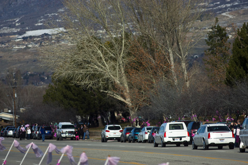Chris Detrick  |  The Salt Lake Tribune Emilie Parker's hearse drives along Monroe Blvd to Myers Evergreen Memorial Park Saturday December 22, 2012.  Emilie Parker, 6, was one of 20 children massacred by a gunman Dec. 14 at Sandy Hook Elementary School in Newtown, Conn.
