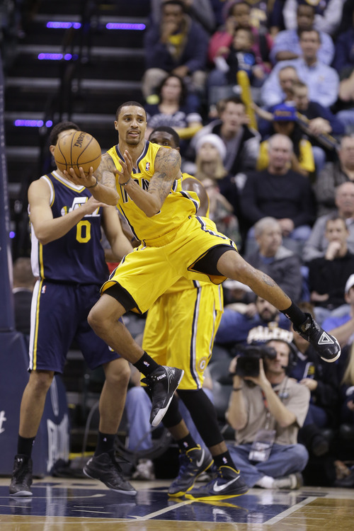 Indiana Pacers point guard George Hill makes a pass against the Utah Jazz in the second half of an NBA basketball game in Indianapolis, Wednesday, Dec. 19, 2012. The Pacers beat the Jazz 104-84.  (AP Photo/Michael Conroy)