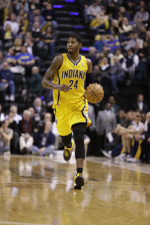 Indiana Pacers small forward Paul George in the first half of an NBA basketball game against the Utah Jazz in Indianapolis, Wednesday, Dec. 19, 2012.  (AP Photo/Michael Conroy)