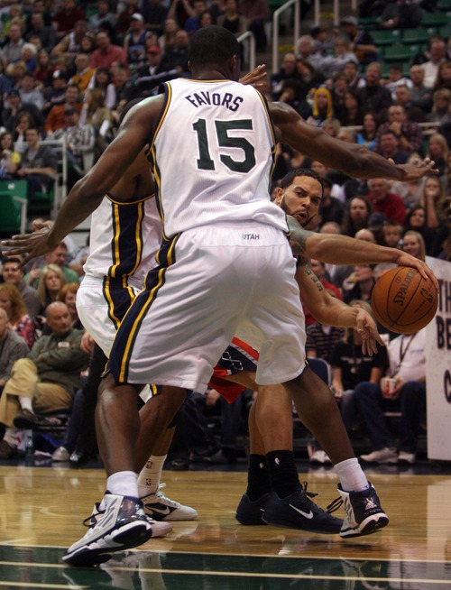 Kim Raff  The Salt Lake Tribune Utah Jazz player Derrick Favors defends New Jersey Nets player Deron Williams during the second half at the Energy Solutions Arena in Salt Lake City, Utah on January 14, 2012.