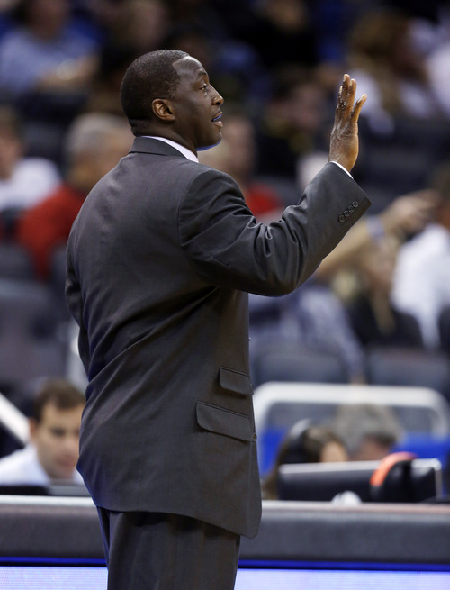 Utah Jazz head coach Tyrone Corbin gives instructions to his team from the sidelines against the Orlando Magic in the second half of an NBA basketball game, Sunday, Dec. 23, 2012, in Orlando, Fla. (AP Photo/Scott Iskowitz)
