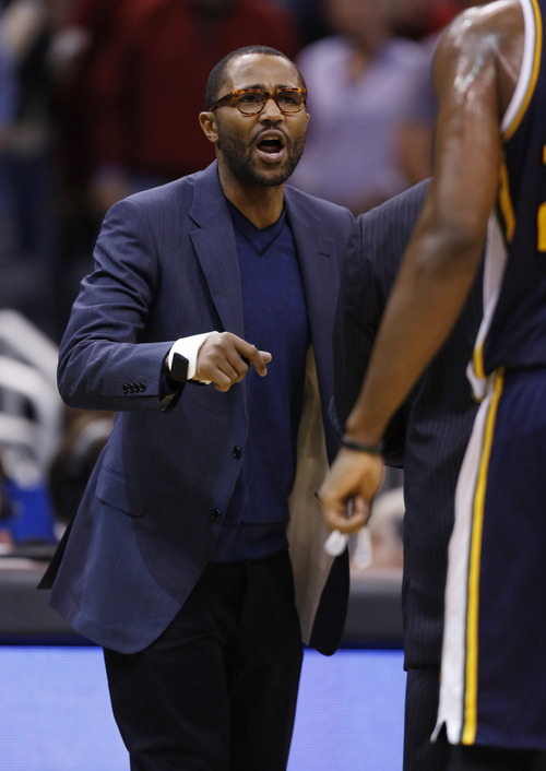 Utah Jazz point guard Mo Williams gives instructions to teammates from the sidelines against the Orlando Magic during the second half of an NBA basketball game, Sunday, Dec. 23, 2012, in Orlando, Fla. The Utah Jazz report that Mo Williams will be out indefinitely due to a right thumb injury. (AP Photo/Scott Iskowitz)
