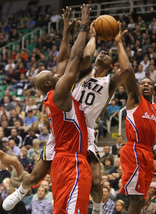 Rick Egan  | The Salt Lake Tribune   Utah Jazz point guard Alec Burks (10) attempts a shot as Los Angeles Clippers power forward Lamar Odom (7) defends, in NBA action, Utah Jazz vs. The Los Angeles Clippers, in Salt Lake City, Monday, December 3, 2012.