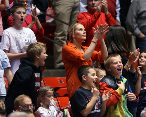 Steve Griffin | The Salt Lake Tribune   Jan Krystkowiak stands with her children and their friends as they cheer for the Utes during a game against SMU at the Huntsman Center in Salt Lake City on Dec. 18, 2012. Jan's husband, Larry Krystkowiak, is the Utes head coach.