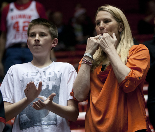 Steve Griffin | The Salt Lake Tribune   Jan Krystkowiak cheers for the Utes, with her son, Cameron, 13, during introduction of the starting lineups before the Utah game against SMU on Dec. 18, 2012. Jan's husband, Larry Krystkowiak, is the Utes head coach.