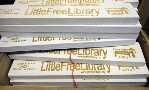 In this Thursday, Dec. 6, 2012, photo, the nameplates for  the Little Free Libraries lending boxes are shown in Hudson, Wis. The non-profit Little Free Libraries movement is branching out in new directions including inner-city neighborhoods where kids might not have many books and into developing countries were people are hungry for reading material and by Christmas expects its followers will have erected over 5,000 book boxes across the U.S. alone.(AP Photo/Jim Mone)