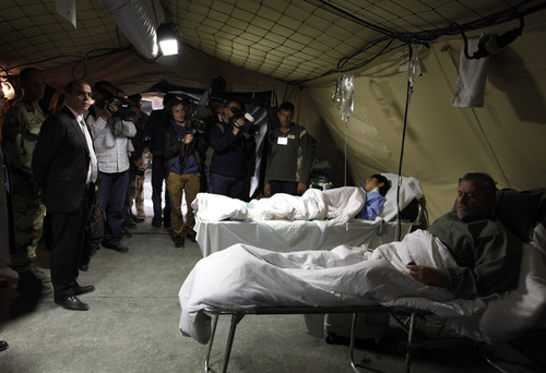 Kader Arif, French Minister for Veteran affairs, second left, visits one of the tents of the French military mobile hospital at Zaatari Syrian refugee camp, near the Syrian border in Mafraq, Jordan, Tuesday, Dec. 25, 2012. (AP Photo/Mohammad Hannon)