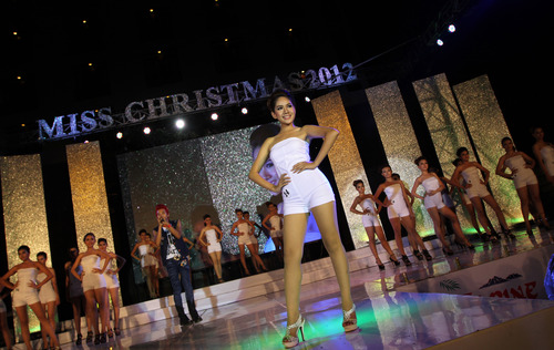 In this photo taken on Monday, Dec. 24, 2012, a contestant poses during Miss Christmas Beauty Contest at a hotel in Yangon, Myanmar. (AP Photo/Khin Maung Win)