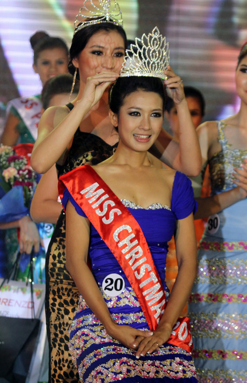 In this photo taken on Monday, Dec. 24, 2012, Helin Myo Ko, winner of Miss Christmas Beauty Contest, receives crown at a hotel in Yangon, Myanmar. (AP Photo/Khin Maung Win)