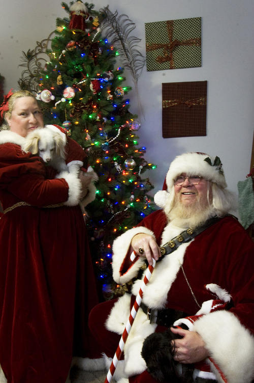 Kim Raff  |  The Salt Lake Tribune Santa Claus, his wife Alise Claus, and their dogs (left) Crystal and Coal at their home in Murray on Dec. 23, 2012.  Claus legally changed his name from David Lynn Porter after a lengthy court battle.