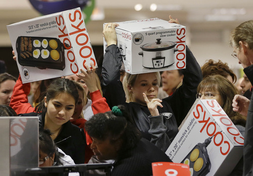 You can avoid the holiday shopping crush -- and get some bargains -- if you wait until after Christmas to do your shopping. (AP Photo/Julie Jacobson)