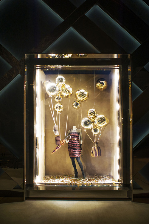 This undated publicity photo provided by BURBERRY shows a window display on the exterior of the new BURBERRY Flagship store opened in November 2012 on Michigan Avenue in Chicago. BURBERRY has been known for generations for its signature check pattern and trenchcoat. But it's been chief executive officer, Angela Ahrendts, and chief creative officer, Christopher Bailey, who have pushed the brand's digital, and now mobile, boundaries. (AP Photo/BURBERRY)