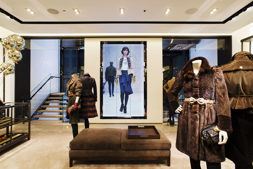 This undated publicity photo provided by BURBERRY shows an interior view of the BURBERRY PRORSUM section of the new BURBERRY Flagship store opened in November 2012 on Michigan Avenue in Chicago. BURBERRY has been known for generations for its signature check pattern and trenchcoat.  The company has monthly updates at Burberry.com, where CEO, Angela Ahrendts said, more people visit every week than walk into all the brand's stores around the world combined. (AP Photo/BURBERRY)