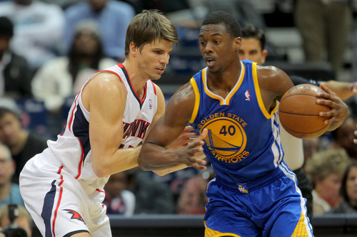 Golden State Warriors small forward Harrison Barnes (40) drives against Atlanta Hawks shooting guard Kyle Korver in the first half of an NBA basketball game on Saturday, Dec. 15, 2012, in Atlanta. (AP Photo/Todd Kirkland)