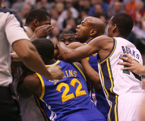 Steve Griffin   The Salt Lake Tribune   Utah's Derrick Favors sand Golden State's Jarrett Jack scuffle as Charles Jenkins of the Warriors and Alec Burks of the Jazz try to break them up during first half action of the Utah Jazz Versus Golden State Warriors game at EnergySolutions Arena in Salt Lake City, Utah Wednesday December 26, 2012.