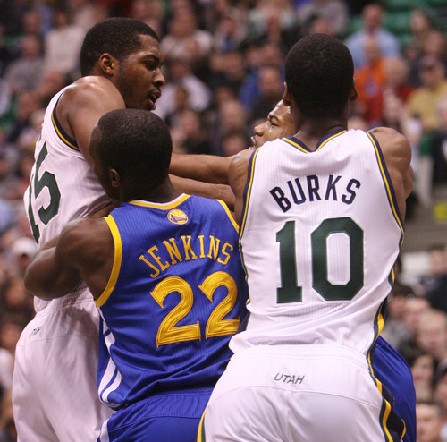 Steve Griffin | The Salt Lake Tribune   Utah's Derrick Favors sand Golden State's Jarrett Jack scuffle as Charles Jenkins of the Warriors and Alec Burks of the Jazz try to break them up during first half action of the Utah Jazz Versus Golden State Warriors game at EnergySolutions Arena in Salt Lake City, Utah Wednesday December 26, 2012.