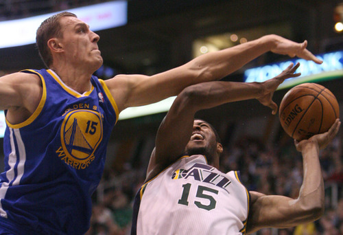 Steve Griffin | The Salt Lake Tribune   Golden State's Andris Biedrins defendes Utah's Derrick Favors  during first half action of the Utah Jazz Versus Golden State Warriors game at EnergySolutions Arena in Salt Lake City, Utah Wednesday December 26, 2012.