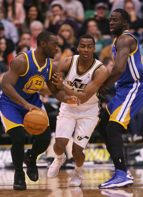 Steve Griffin | The Salt Lake Tribune   Utah's Alec Burks, center, chases Golden State's Charles Jenkins during first half action of the Utah Jazz Versus Golden State Warriors game at EnergySolutions Arena in Salt Lake City, Utah Wednesday December 26, 2012.