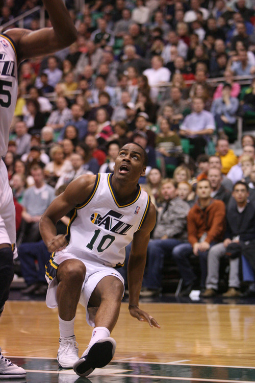Steve Griffin | The Salt Lake Tribune   Utah's Alec Burks watches his shot roll out as he falls to the floor during first half action of the Utah Jazz Versus Golden State Warriors game at EnergySolutions Arena in Salt Lake City, Utah Wednesday December 26, 2012.