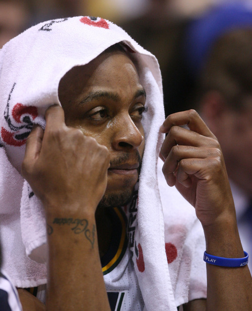 Steve Griffin | The Salt Lake Tribune   Utah's Randy Foye puts a towel over his head after coming out of the game during first half action of the Utah Jazz Versus Golden State Warriors game at EnergySolutions Arena in Salt Lake City, Utah Wednesday December 26, 2012.