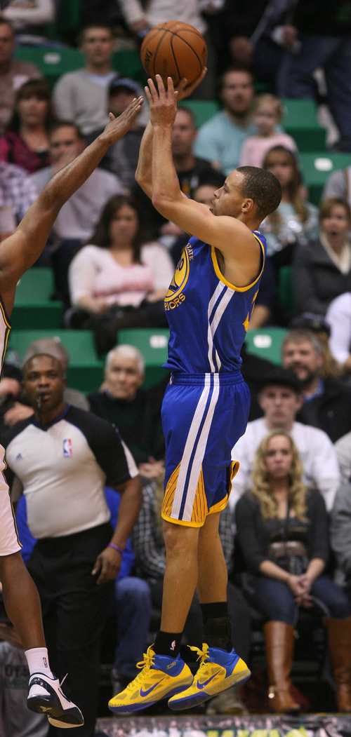 Steve Griffin | The Salt Lake Tribune   Golden States Stephen Curry launches a three-pointer during first half action of the Utah Jazz Versus Golden State Warriors game at EnergySolutions Arena in Salt Lake City, Utah Wednesday December 26, 2012.