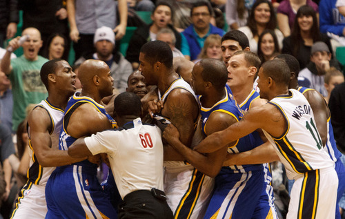 Trent Nelson  |  The Salt Lake Tribune Golden State's Jarrett Jack and Utah Jazz power forward Derrick Favors (15) share a heated moment, as teammates and officials try to pull them apart, as the Utah Jazz host the Golden State Warriors, NBA basketball Wednesday December 26, 2012 in Salt Lake City.