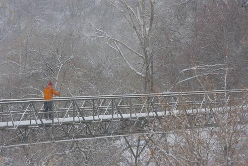 Paul Fraughton  |  The Salt Lake Tribune A cross-country skier slides across the snow covered foot bridge at Salt Lake City's Bonneville Golf Course.  Wednesday, December 26, 2012
