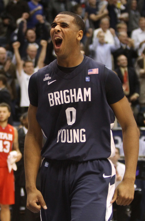 Rick Egan  | The Salt Lake Tribune   Brigham Young Cougars forward Brandon Davies (0) cheers as at the buzzer as BYU defeats Utah 61-58, in basketball action between the Brigham Young Cougars and the Utah Utes at the Marriott Center in Provo, Saturday, December 8, 2012.
