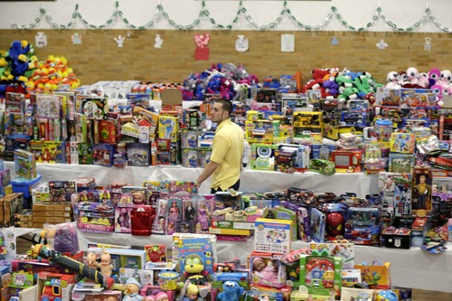 Seth Wenig  |  The Associated Press Volunteer Anthony Vessicchio of East Haven, Conn., helps to sort tables full of donated toys at the town hall in Newtown, Conn., Friday, Dec. 21, 2012.