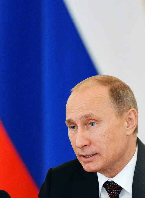 Russian President Vladimir Putin speaks at a State Council meeting in the Kremlin in Moscow, Thursday, Dec. 27, 2012. Vladimir Putin said on Thursday that he will sign a controversial bill banning Americans from adopting Russian children. (AP Photo/Natalia Kolesnikova, Pool)