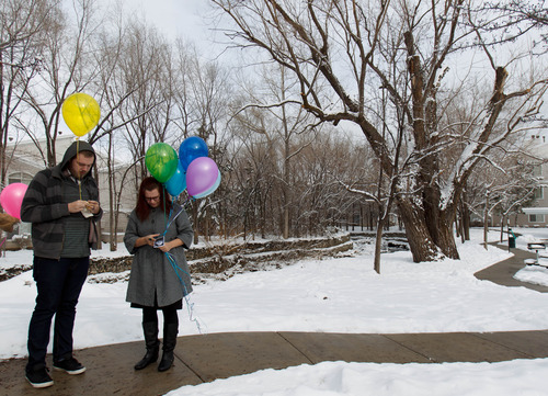 Trent Nelson  |  The Salt Lake Tribune Stephanie Cook prepares to release balloons to mark the day her mother, Bobbi Campbell, disappeared 18 years ago. Thursday December 27, 2012 in Cottonwood Heights. At left is her husband Trevin Cook.