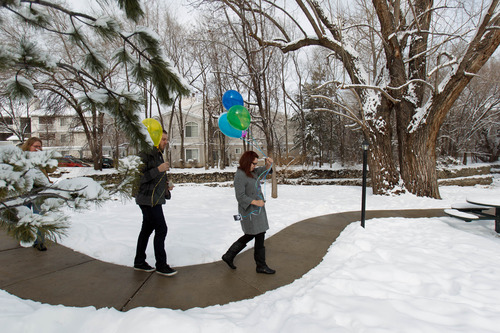 Trent Nelson  |  The Salt Lake Tribune Stephanie Cook prepares to release balloons to mark the day her mother, Bobbi Campbell, disappeared 18 years ago. Thursday December 27, 2012 in Cottonwood Heights. At left is Rebecca Storrs and Cook's husband Trevin Cook.