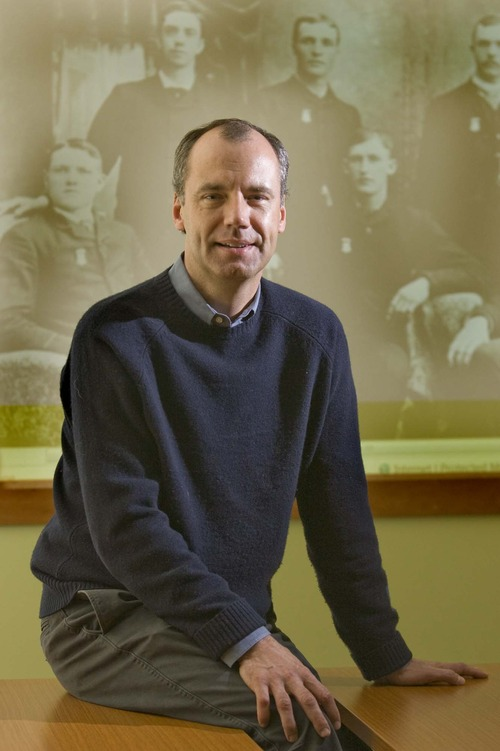 Tim Sullivan,the CEO of Ancestory.com in front of a photo featuring his  great grandfather, Thomas J. Sullivan (lower left) Wednesday, April 7,2010  photo:Paul Fraughton/ The Salt Lake Tribune