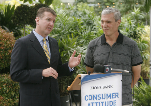Rick Egan  | The Salt Lake Tribune   Randy Shumway, (left) CEO of The Cicero Group/Dan Jones and Associates, gives the monthly Consumer Attitude Index for Zion's Bank  along with Scott Pynes, owner of Cactus and Tropicals, Tuesday, July 31, 2012.