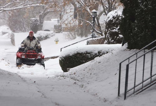 """Leah Hogsten     The Salt Lake Tribune """"This is nothing,"""" said Travis Wardell of Ogden of the amount of snow that fell on the city while plowing his street Wednesday December 26, 2012. Wardell moved to Utah this year from Helena, Montana."""