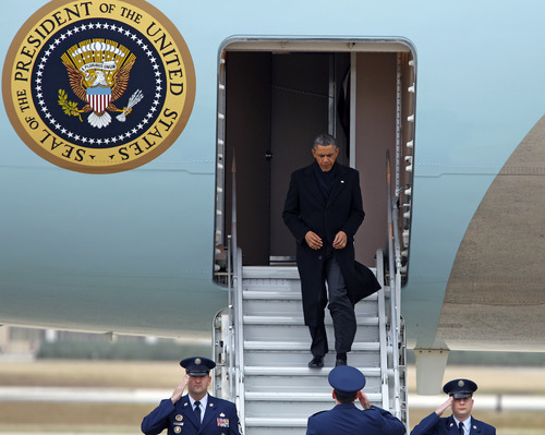 "President Barack Obama walks down the the lower steps instead of the usual longer stairway from Air Force One upon his arrival at Andrews Air Force Base, Md., Thursday, Dec. 27,  2012. The president cut short his holiday and returned to Washington as no deal appeared in sight to avoid the year-end ""fiscal cliff"" of higher taxes and deep spending cuts that could spin the still-fragile back into a recession. The treasury secretary warned that the government would hit its borrowing limit on Monday, the final day of the year.  (AP Photo/Jose Luis Magana)"