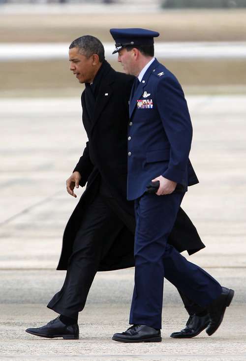 President Barack Obama walks with Col. Greg N. Urtso Vice Commander of the 11th Wing, upon arrival at Andrews Air Force Base, Md.,Thursday, Dec. 27,  2012. Obama is returning from his vacation in Hawaii. ( AP Photo/Jose Luis Magana)