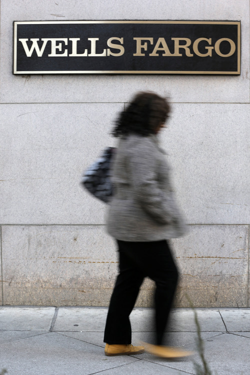 (AP Photo/Matt Rourke) The money banks had to set aside for possible losses fell 15 percent in the July-September quarter from a year earlier. Loan portfolios have strengthened as more customers have repaid on time.